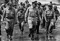 National Archives 111-SC-349595 General MacArthur and soldiers walk from LSTs through the water onto Leyte Island, Philippines, October 1944.